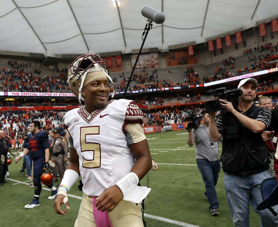 Florida State quarterback Jameis Winston smiles as he walks off the field after his team's 38-20 win over Syracuse in an NCAA college football game, Saturday, Oct. 11, 2014, in Syracuse, N.Y. (AP Photo/Mike Groll) Photo: Mike Groll, Associated Press