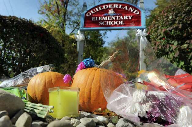 A memorial grows for Anthony Chen, 10, and his brother Eddy Chen, 7, on Tuesday, Oct. 14, 2014, at Guilderland Elementary in Guilderland, N.Y. They, along with their parents Jin Chen and Hai Yan Li, were found dead inside their home on Western Avenue. (Cindy Schultz / Times Union) Photo: Cindy Schultz / 10029034A