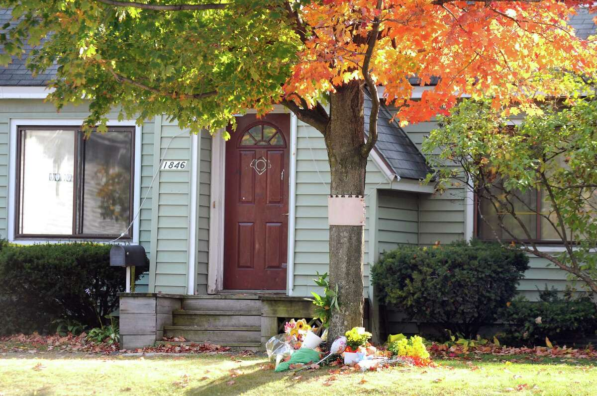 A memorial outside 1846 Western Ave. on Tuesday, Oct. 14, 2014, in Guilderland, N.Y. Jin Chen and Hai Yan Li and their sons Anthony, 10, and Eddy, 7, all of Chinese decent, were found dead inside the home last Wednesday. (Cindy Schultz / Times Union)