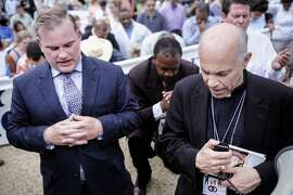 San Francisco Archbishop Salvatore Cordileone, right, and Brian Brown, left, march organizer and president of the National Organization of Marriage, kneel to pray as participants in the March for Marriage gather across from the Supreme Court in Washington, DC on June 19, 2014. Speakers at the rally and march promoted the definition of marriage as between a man and a woman, and pushed back against the notion that public opinion is heavily in favor of revoking restrictions against gay marriage.