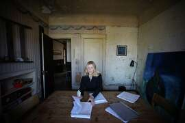 Jacqui Naylor goes over sheet music for a set list in her Gough St. apartment on Thursday, Aug. 21, 2014 in San Francisco, Calif. Naylor faced an Ellis Act eviction.