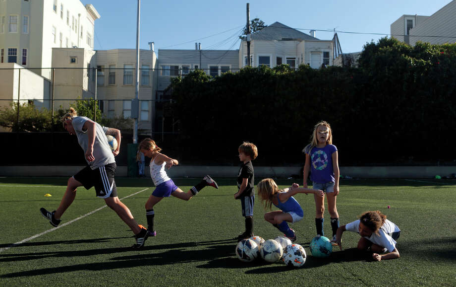 San Francisco Futbol Club coach Krysta Jenkins (left) leads a practice Monday at the Mission Playground soccer field on Oct 13. Photo: Scott Strazzante / The Chronicle / ONLINE_YES