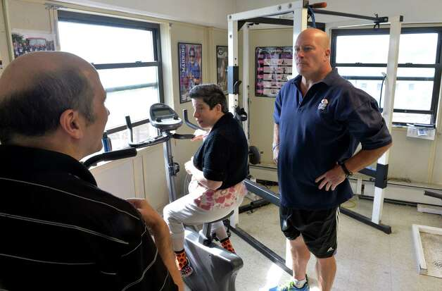 Ned Norton works with members of the Warriors on Wheels program at his gym on Street Wednesday morning, Oct. 8, 2014, in Albany, N.Y.   (Skip Dickstein/Times Union) Photo: SKIP DICKSTEIN / 10028942A
