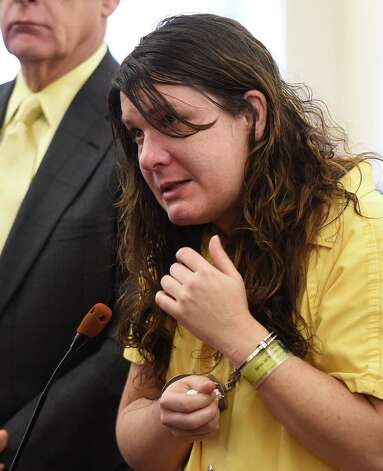 Defendant Sara Moore received a sentence of 25 years to life from Judge Stephen Herrick Tuesday morning Oct. 14, 2014 in Albany County Court in Albany, N.Y. for the murder of a 79 year old man that she was caring for. (Skip Dickstein/Times Union) Photo: SKIP DICKSTEIN / 10029026A
