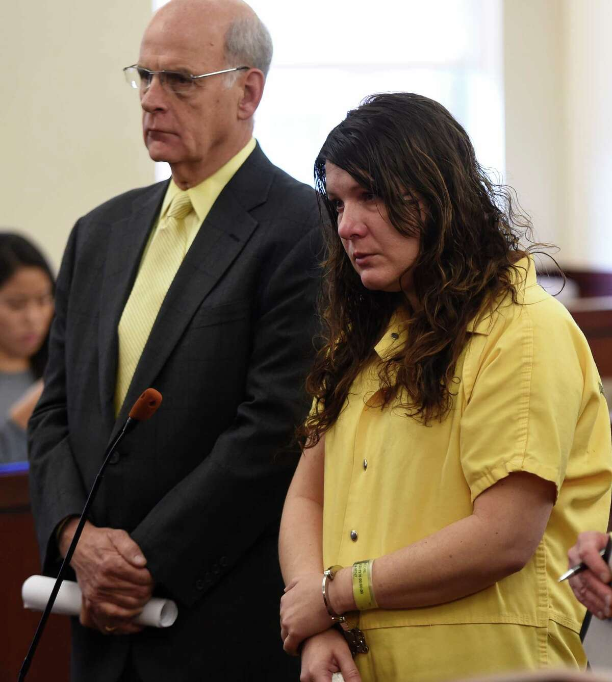 Defendant Sara Moore received a sentence of 25 years to life from Judge Stephen Herrick Tuesday morning Oct. 14, 2014 in Albany County Court in Albany, N.Y. for the murder of a 79 year old man that she was caring for. With Moore is her attorney Stephen Coffey. (Skip Dickstein/Times Union)