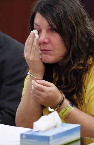 Defendant Sara Moore wipes tears from her eyes before she received a sentence of 25 years to life from Judge Stephen Herrick Tuesday morning Oct. 14, 2014 in Albany County Court in Albany, N.Y. for the murder of a 79 year old man that she was caring for.   (Skip Dickstein/Times Union) Photo: SKIP DICKSTEIN / 10029026A