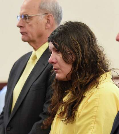 Defendant Sara Moore received a sentence of 25 years to life from Judge Stephen Herrick Tuesday morning Oct. 14, 2014 in Albany County Court in Albany, N.Y. for the murder of a 79 year old man that she was caring for.   With Moore is her attorney Stephen Coffey. (Skip Dickstein/Times Union) Photo: SKIP DICKSTEIN / 10029026A