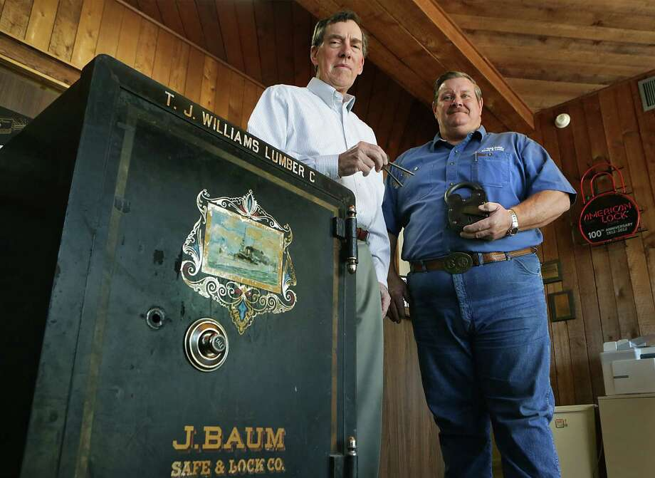 Ed Griepenkerl (left) has turned over the keys of the 85-year-old J. Ross Boles Co. to new owner Brian Barnes, who's given it a new name, J. Ross Boles Locks and Keys LLC, and relocated to a new building at 1701 N. St. Mary's St. Photo: Photos By Bob Owen / San Antonio Express-News / © 2014 San Antonio Express-News