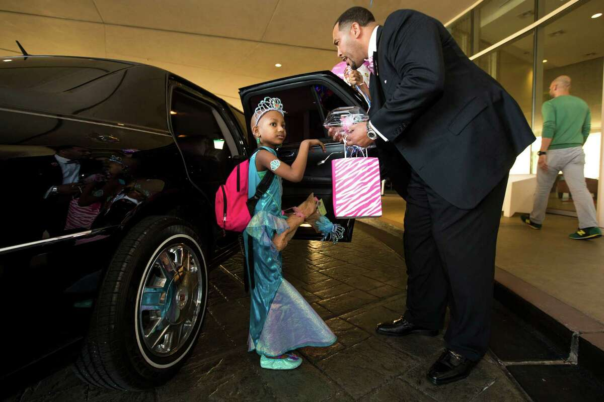 Kyssi Andrews is picked up for her 6th birthday dinner by personal trainer Troy Cousin on Tuesday, Oct. 14, 2014, in Houston.