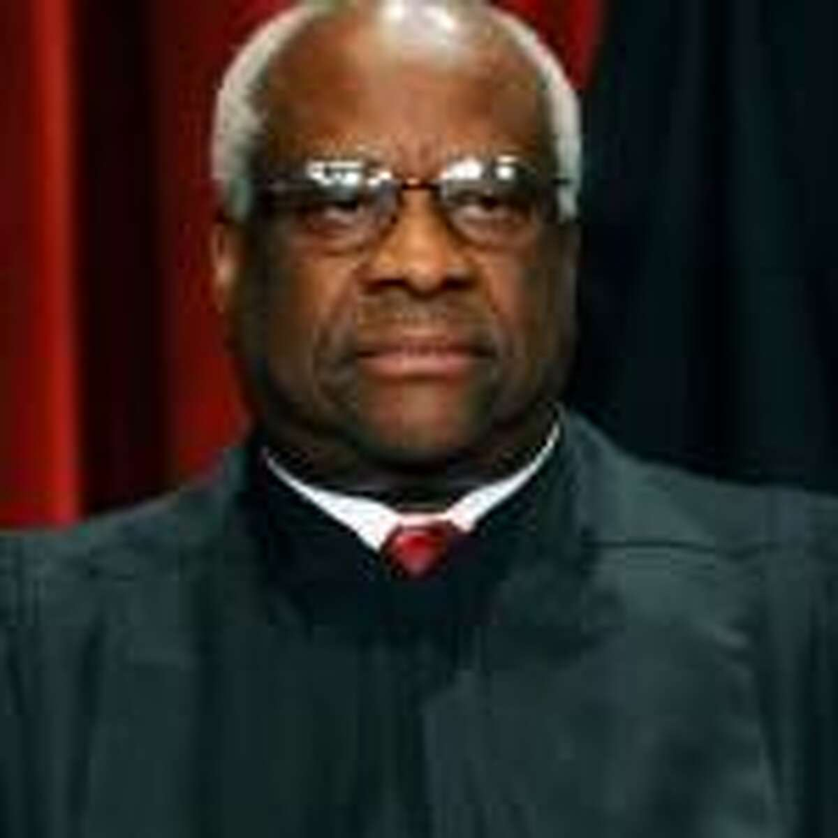 U.S. Supreme Court Justice Clarence Thomas: He's grown talkative since court begam hearing cases by teleconferencing.