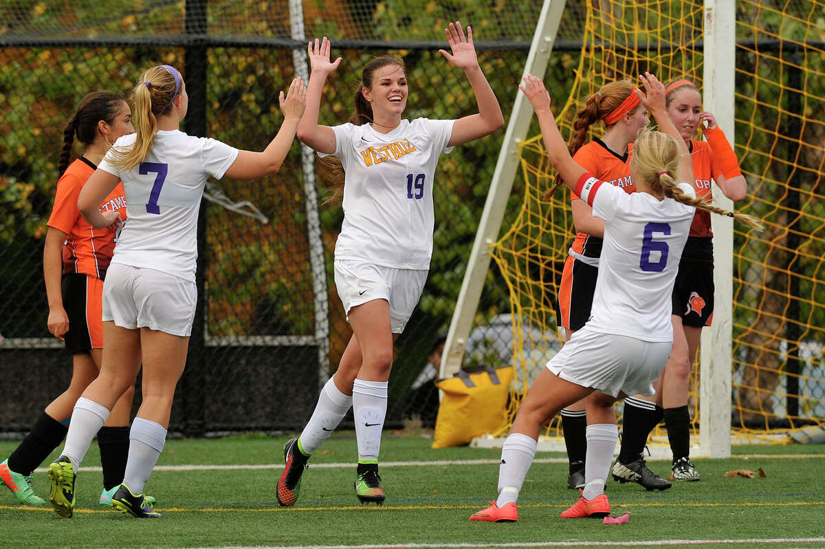 Jess Laszlo celebrates with her team after scoring a goal during their game against Stamford at Westhill High School in Stamford, Conn., on Tuesday, Oct. 14, 2014. Westhill won, 4-0. Laszlo scored three of the four goals in the match.