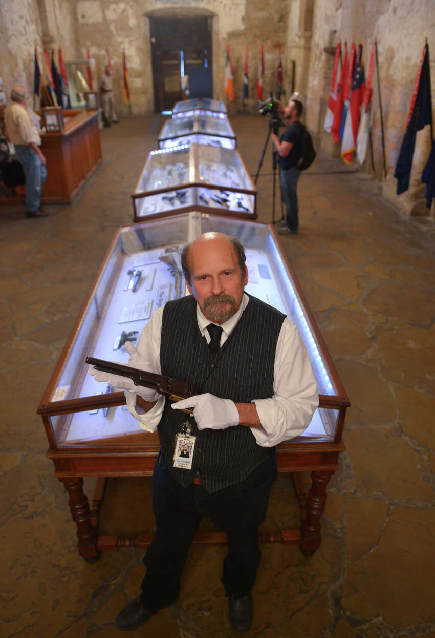 Alamo Historian and Curator Dr. Bruce Winders displays the