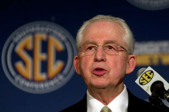 FILE - In this July 20, 2011, file photo, Southeastern Conference Commissioner Mike Slive talks with reporters during SEC media days in Hoover, Ala. Slive will retire next summer after 13 years leading the league and plans to begin treatment for a recurrence of prostate cancer. The 74-year-old Slive said his retirement will take effect July 31. (AP Photo/Dave Martin, File)
