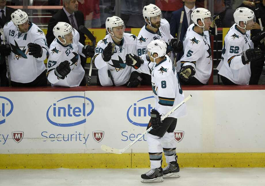 San Jose Sharks center Joe Pavelski (8) celebrates his shootout goal against the Washington Capitals during an NHL hockey game, Tuesday, Oct. 14, 2014, in Washington. The Sharks won 6-5. (AP Photo/Nick Wass) Photo: Nick Wass, Associated Press