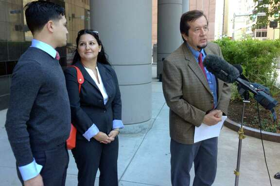 Jay Mazoch, his mother Leanne Mazoch and his attorney Randall Kallinen (left to right).  Mazoch has filed a lawsuit in federal court alleging that his constitutional rights were violated when he was shot in the face by police when he stopped his vehicle to talk with them in October 2012.