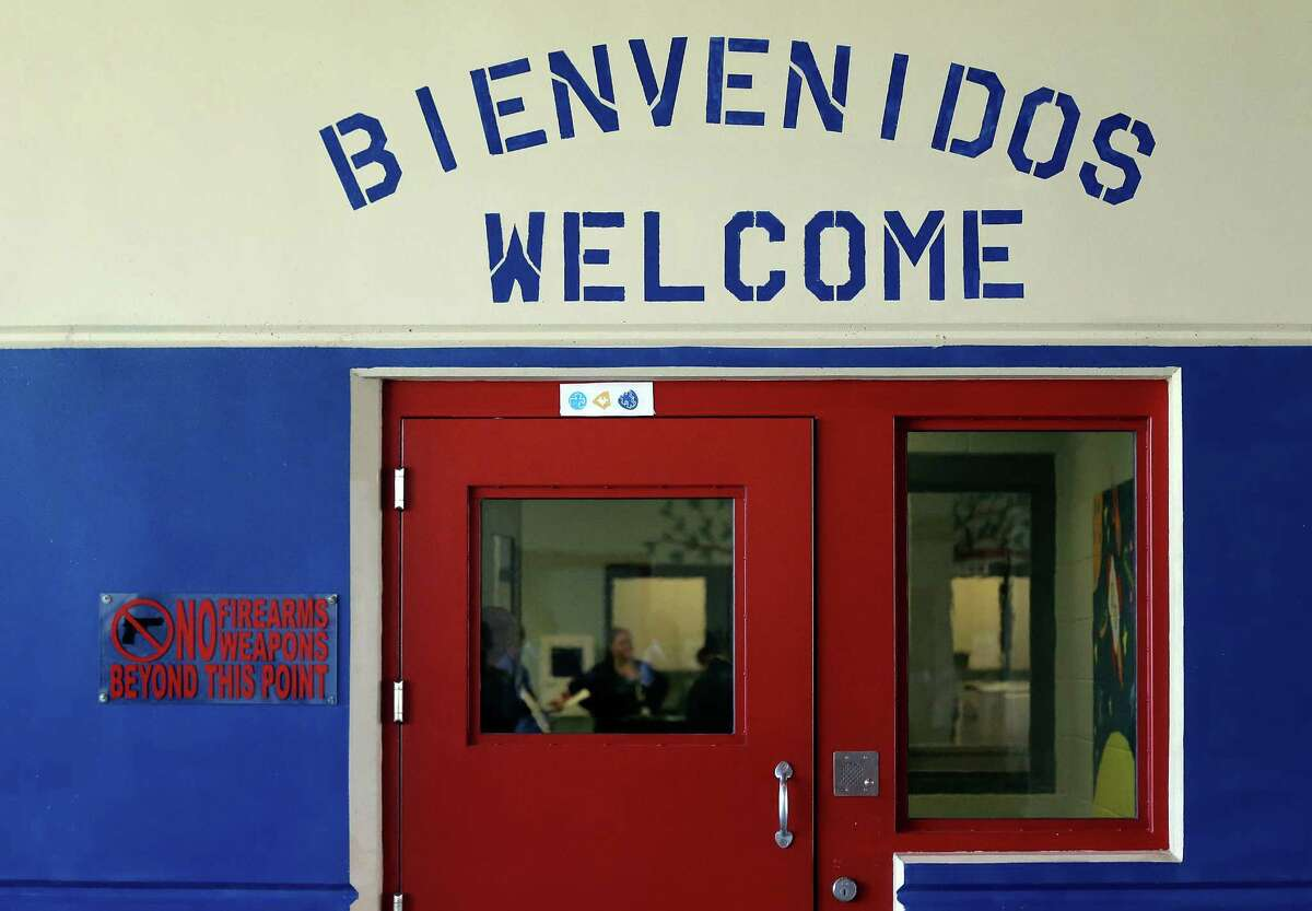 File - In this July 31, 2014 file photo, a Spanish and English welcome sign is seen above a door in a secured entrance area at the Karnes County Residential Center in Karnes City, Texas. Attorneys have filed complaints with federal immigration officials alleging sexual abuse and harassment at the immigration lockup that houses women and their children. The attorneys filed a complaint with Immigration and Customs Enforcement on Sept. 25 and the Department of Homeland Security on Tuesday, Oct. 1. (AP Photo/Eric Gay, File)