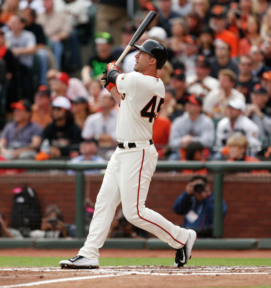 "Travis Ishikawa crushes a three-run double to right-center in the first inning, hitting ""that ball as well as I can hit a ball."" Photo: Scott Strazzante / The Chronicle / ONLINE_YES"