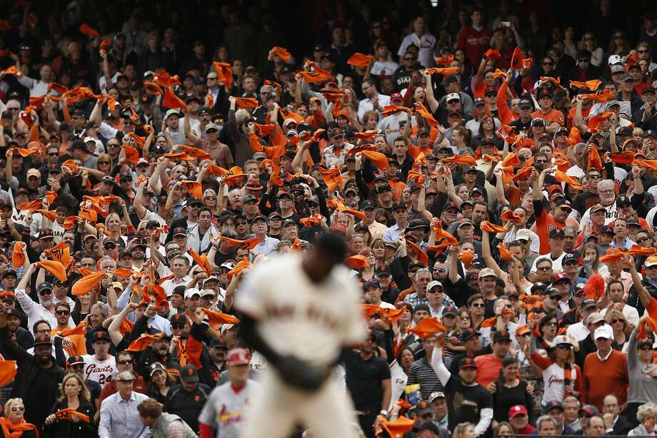 Fans show their spirit in the ninth inning during Game 3 of the NLCS at AT&T Park on Tuesday, Oct. 14, 2014 in San Francisco, Calif. Photo: Scott Strazzante, The Chronicle
