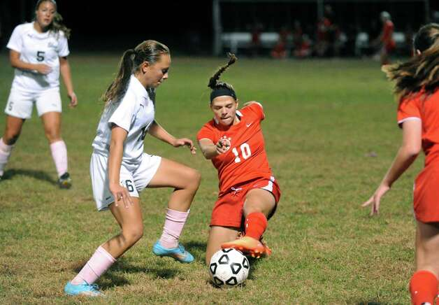Shen's Amanda Volk and Niskayuna's Alissa Franze battle for the ball during their girl's high school soccer game on Tuesday Oct. 14, 2014 in Clifton Park, N.Y.  (Michael P. Farrell/Times Union) Photo: Michael P. Farrell / 10028989A