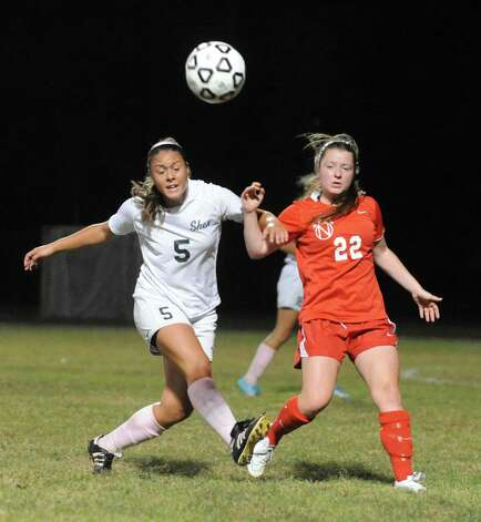 Shen's Kelsie Moinzadeh and Niskayuna's Catherine Sexton battle for the ball during their girl's high school soccer game on Tuesday Oct. 14, 2014 in Clifton Park, N.Y.  (Michael P. Farrell/Times Union) Photo: Michael P. Farrell / 10028989A