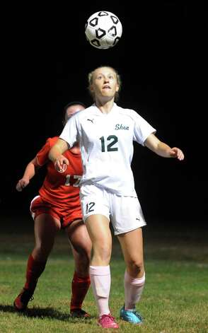 Shen's Katie Benson and Niskayuna's Kaitlin Davis battle for the ball during their girl's high school soccer game on Tuesday Oct. 14, 2014 in Clifton Park, N.Y.  (Michael P. Farrell/Times Union) Photo: Michael P. Farrell / 10028989A