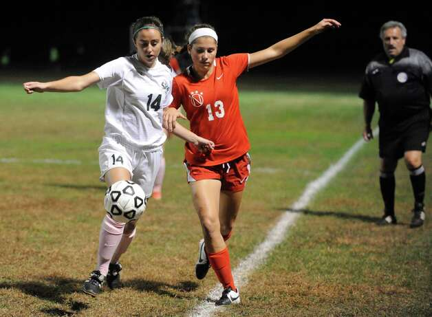 Shen's Sophia Phillips and Niskayuna's Mimi Curro battle for the ball during their girl's high school soccer game on Tuesday Oct. 14, 2014 in Clifton Park, N.Y.  (Michael P. Farrell/Times Union) Photo: Michael P. Farrell / 10028989A