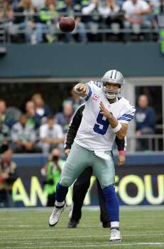 Tony Romo threw for 250 yards and two touchdowns Sunday in a 30-23 win on the road against Seattle. Photo: Photo By Photo By Elaine Thompson | AP / AP