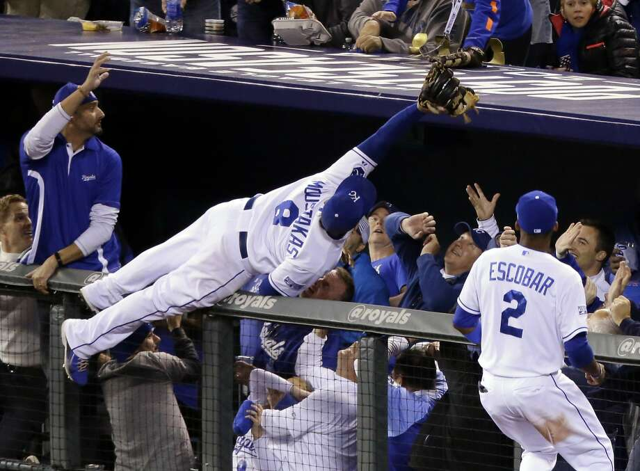 Kansas City Royals third baseman Mike Moustakas makes a catch on a ball hit by Baltimore Orioles' Adam Jones during the sixth inning of Game 3 of the American League baseball championship series Tuesday, Oct. 14, 2014, in Kansas City, Mo. (AP Photo/Michael Conroy) Photo: Michael Conroy, Associated Press