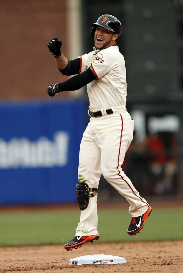 San Francisco Giants' Gregor Blanco celebrates his bunt in 10th inning that led to throwing error by St. Louis Cardinals' Randy Choate scoring winning run during Giants' 5-4 win in Game 3 of the NLCS at AT&T Park in San Francisco, Calif. on Tuesday, October 14, 2014. Photo: Scott Strazzante, The Chronicle