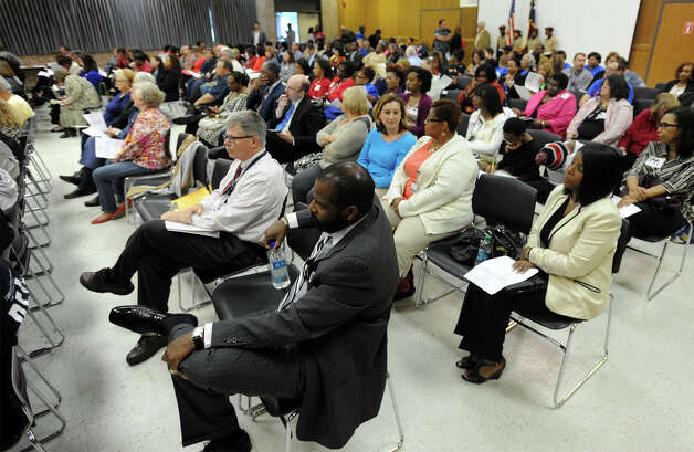 A filled room listens in to the Beaumont Independent School District's meeting Tuesday night.  Photo taken Tuesday, October 14, 2014  Guiseppe Barranco/@spotnewsshooter Photo: Guiseppe Barranco, Photo Editor