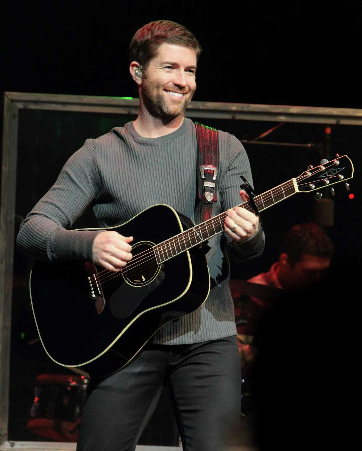 """Country music artist Josh Turner performs in concert during his """"Punching Bag Tour 2014"""" at the American Music Theater on Monday, Jan. 20, 2014, in Lancaster, Pa. (Photo by Owen Sweeney/Invision/AP)"""