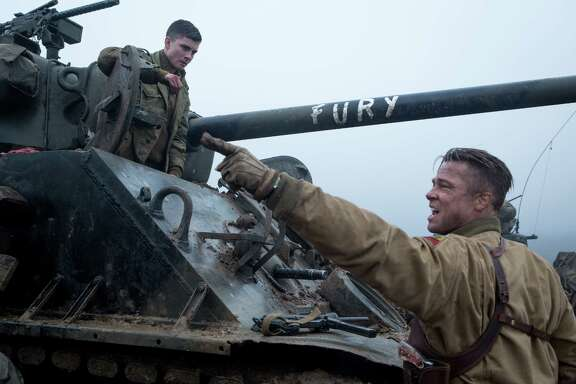 Norman (Logan Lerman) and Wardaddy (Brad Pitt) in Columbia Pictures' FURY. Photo By: Giles Keyte Copyright:   2014 CTMG, Inc. All Rights Reserved. **ALL IMAGES ARE PROPERTY OF SONY PICTURES ENTERTAINMENT INC. FOR PROMOTIONAL USE ONLY. SALE, DUPLICATION OR TRANSFER OF THIS MATERIAL IS STRICTLY PROHIBITED