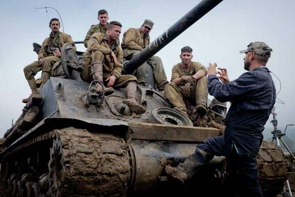 Shia LeBeouf, Logan Lerman, Brad Pitt, Michael Pena, Jon Bernthal with Director David Ayer on the set of Columbia Pictures' FURY. Photo By: Giles Keyte Copyright:   2014 CTMG, Inc. All Rights Reserved. **ALL IMAGES ARE PROPERTY OF SONY PICTURES ENTERTAINMENT INC. FOR PROMOTIONAL USE ONLY. SALE, DUPLICATION OR TRANSFER OF THIS MATERIAL IS STRICTLY PROHIBITED