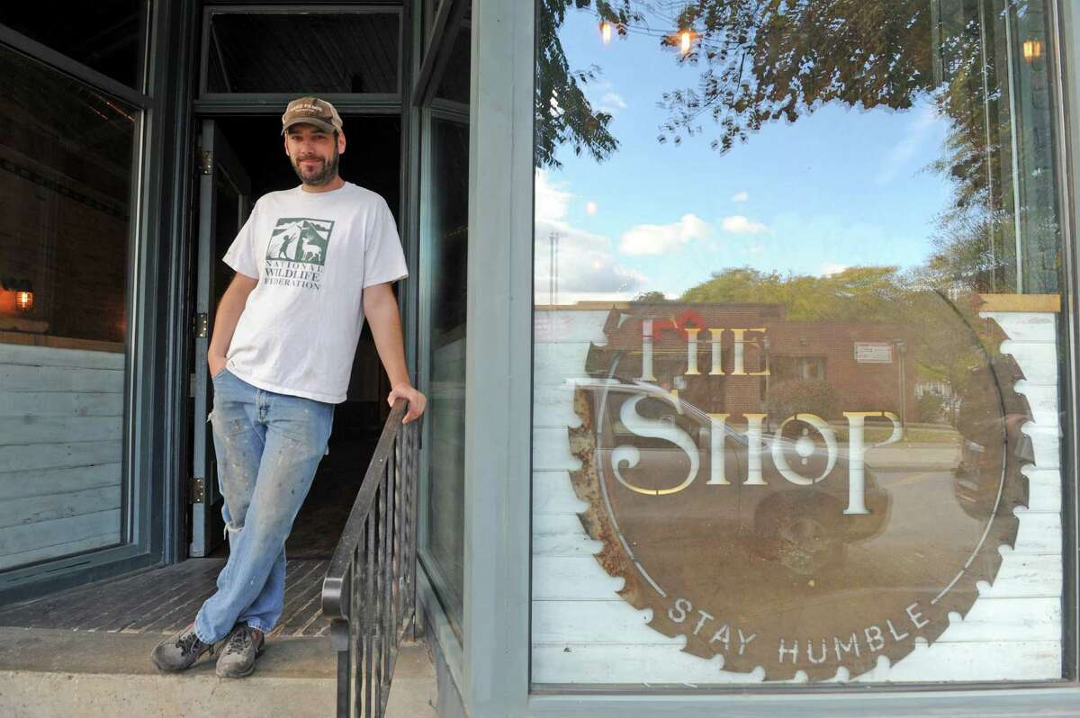 Kevin Blodgett in front of his new bar called The Shop on Friday Oct. 10, 2014 in Troy, N.Y. A 35,000-square-foot Troy building that was home to the former Trojan Hardware for more than 90 years will soon have three street-level spaces devoted to food and drink. The building, on the corner of Fourth and Congress streets, was redeveloped over the past nine years by owner Kevin Blodgett, who did the renovations himself and is opening two of the businesses, a restaurant-bar called The Shop and a deli called Harrison's Corner Market. (Michael P. Farrell/Times Union)