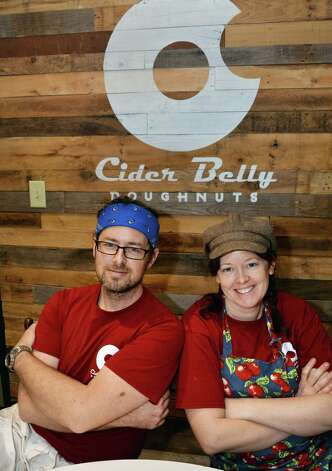 Albany natives Andy Novak, left, and his sister Jennifer Novak  in their Cider Belly Doughnuts shop on North Pearl Street Thursday Oct. 9, 2014, in Albany, NY.  (John Carl D'Annibale / Times Union) Photo: John Carl D'Annibale / 10028944A