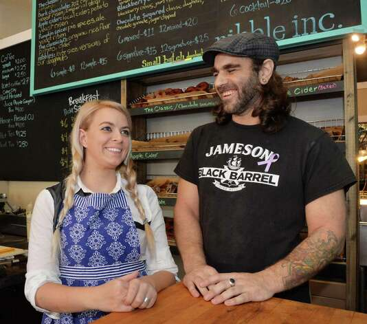 Co owners Jessie Cramer, left, and Michael Cunningham at Nibble, Inc. on Broadway Thursday Oct. 2014, in Troy, NY.  (John Carl D'Annibale / Times Union) Photo: John Carl D'Annibale / 10028960A