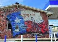 Murals decorate stores in downtown Nederland. Photo taken Wednesday, September 25, 2014 Kim Brent/@kimbpix