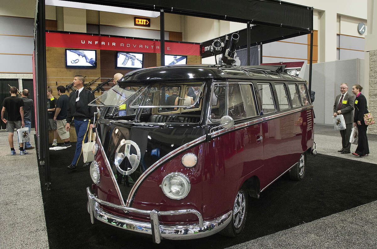 Yep, this is a Volkswagen Bus modified to hold a M-134 Mini-Gun six-barreled machine gun on display at the Magpul weapons booth during the Association of the United States Army Annual Meeting and Exposition in Washington, DC. Magpul Industries Corporation is an American designer and manufacturer of polymer and composite high-tech firearms, accessories and concept firearms and is based in Erie, Colorado.