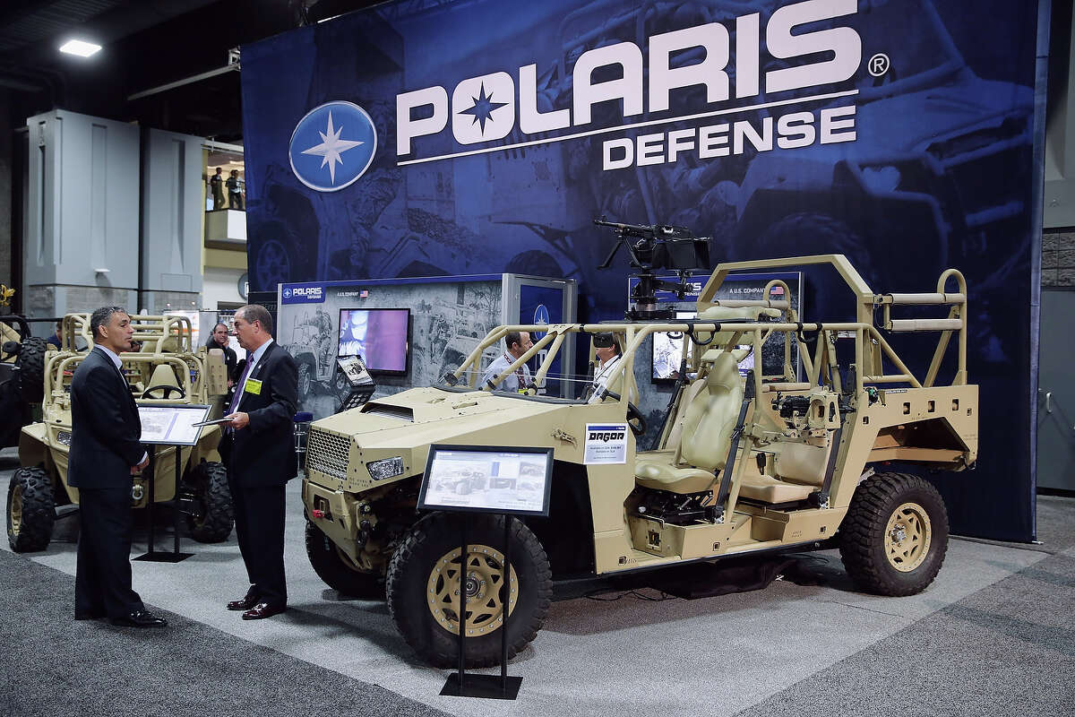 The Polaris Industries Defense exhibit booth displays helicopter-mobile combat vehicles used by U.S. Special Operations during the Association of the United States Army annual meeting and exposition at the Washington Convention Center October 15, 2014 in Washington, DC. The AUSA is a private, non-profit advocacy organization for the United States Army.