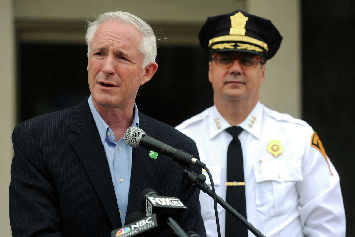 Mayor Bill Finch speaks at a press conference after it was announced that President Obama's visit to Bridgeport Wednesday had been cancelled, in Bridgeport, Conn. Oct. 15, 2014. Finch is seen here with Police Chief Joseph Gaudett.