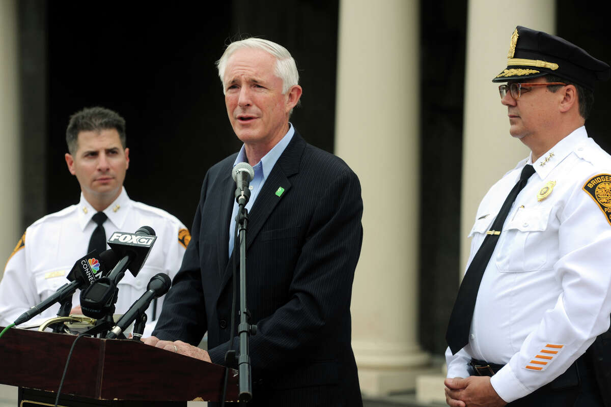 Mayor Bill Finch speaks at a press conference after it was announced that President Obama's visit to Bridgeport Wednesday had been cancelled, in Bridgeport, Conn. Oct. 15, 2014. Finch is seen here with Police Chief Joseph Gaudett, right, and Assistant Police Chief James Nardozzi, left.