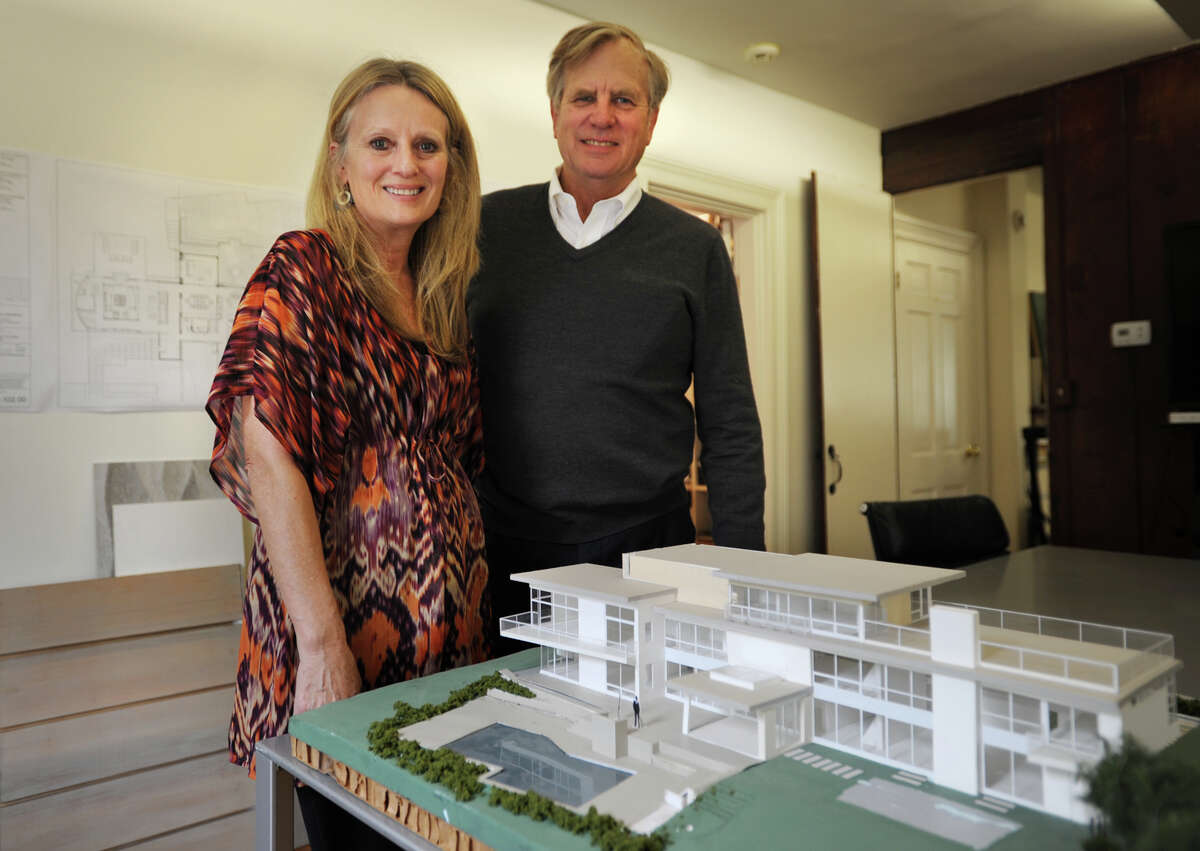 Architects Ann and Howard Lathrop stand by the model of a modern home that they designed at their offices in Westport, Conn. on Wednesday, October 15, 2014.