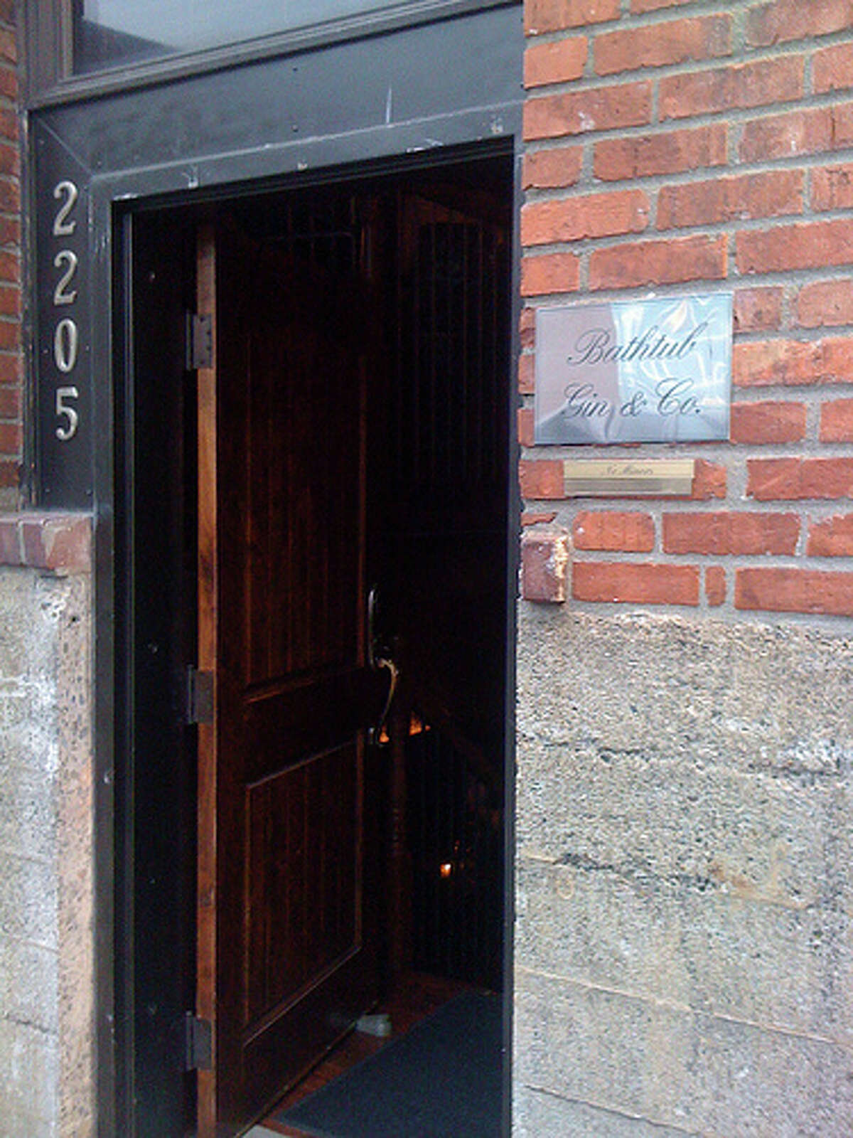 Bathtub Gin runs a dark, brick-walled, speakeasy-style bar in Belltown.