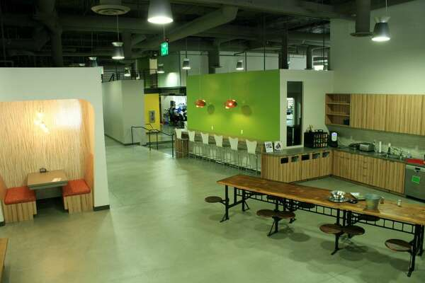 Red Door Interactive, a strategic partnering firm, has an open floor plan for employees to work, eat and play.