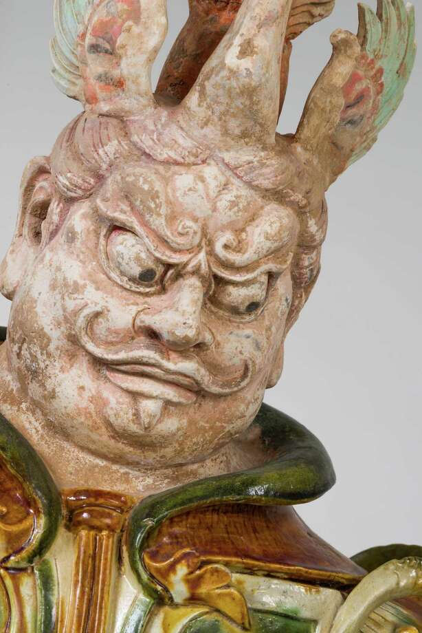 A detail from a pair of Tang Dynasty (618 to 907) Lokapala figures is a fearsome representation of a tomb guard. Photo: Photo By Peggy Tenison