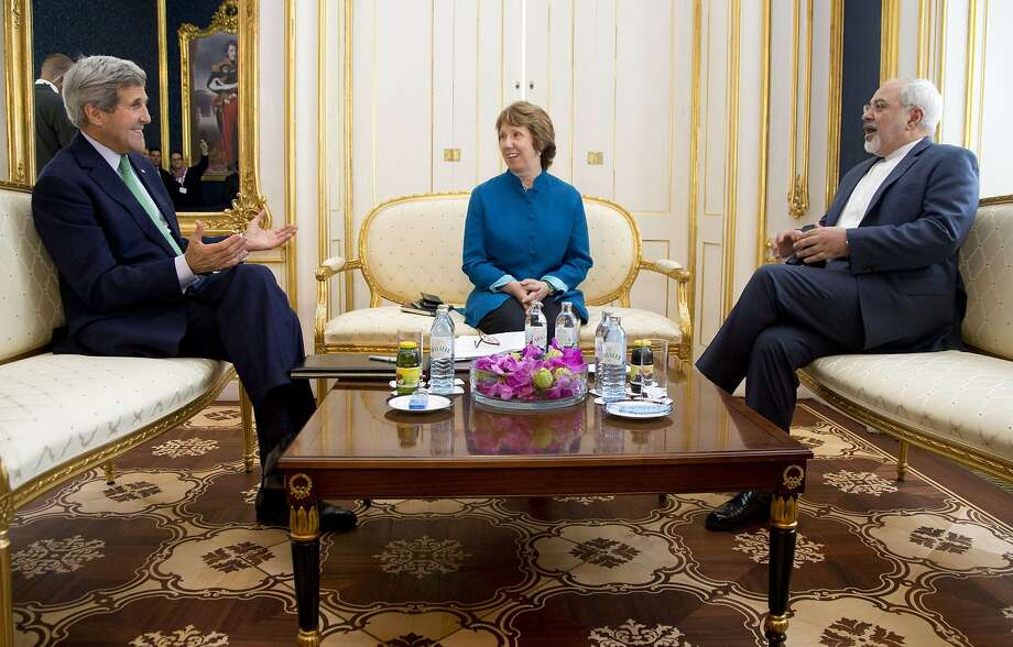 US Secretary of State John Kerry (L), European Union High Representative Catherine Ashton, and Iranian Foreign Minister Mohammad Javad Zarif are photographed as they participate in a trilateral meeting in Vienna, Austria, on October 15, 2014. Kerry meets with Iranian Foreign Minister Mohammad Javad Zarif to try and advance nuclear talks and meet the target date of November 24, 2014.   AFP PHOTO / POOL / CAROLYN KASTERCarolyn Kaster/AFP/Getty Images Photo: Carolyn Kaster, AFP/Getty Images