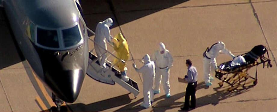 Dallas nurse Amber Vinson walked onto a jet at Love Field to be transferred to Emory University Hospital in Atlanta. Photo: NBC5 Dallas