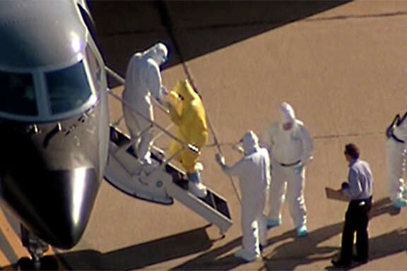 Dallas nurse Amber Vinson walked onto a jet at Love Field to be transferred to Emory University Hospital in Atlanta.