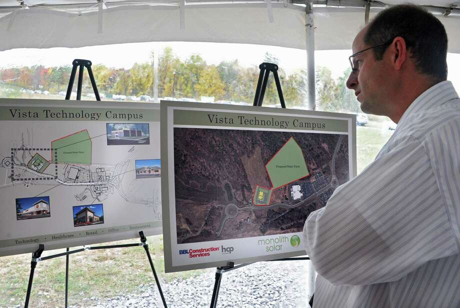 BBL Construction Services employee Mark DeLorenzo looks at site maps at an announcement that Monolith Solar will build its new headquarters, and research and development and manufacturing facility in the Vista Technology Campus at the Vista Technology Campus on Wednesday, Oct. 15, 2014 in Slingerlands, N.Y. (Lori Van Buren / Times Union) Photo: Lori Van Buren / 10029032A