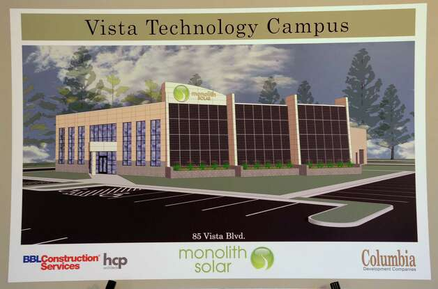 A headquarters rendering is seen on an easel during an announcement that Monolith Solar will build its new headquarters, and research and development and manufacturing facility in the Vista Technology Campus at the Vista Technology Campus on Wednesday, Oct. 15, 2014 in Slingerlands, N.Y. (Lori Van Buren / Times Union) Photo: Lori Van Buren / 10029032A